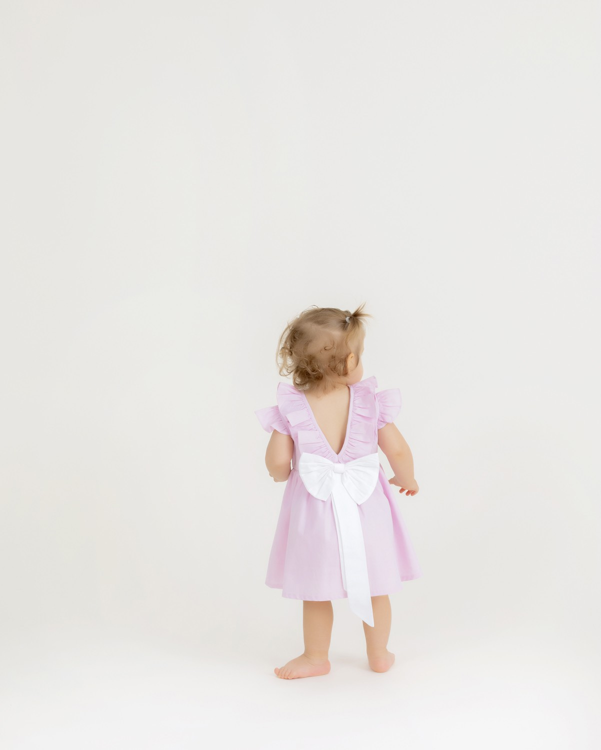Girl's pink bow dress